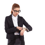 Woman in glasses checking hers watch. Stock Image