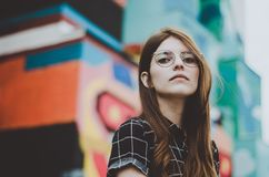 Woman with glasses in city