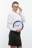 Woman in glasses with clock Royalty Free Stock Photo