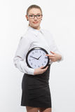 Woman in glasses with clock Royalty Free Stock Photography