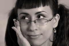 Woman with glasses close up. Sepia Royalty Free Stock Image