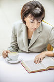 Woman glasses cup book Stock Images
