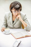 Woman glasses cup book Royalty Free Stock Photos