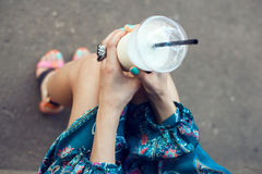 Woman with glasses drinking milkshake Stock Photography