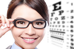 Woman with glasses and eye test chart Stock Image