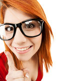 Woman in glasses with finger up Stock Images