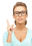 Woman in glasses with finger up Stock Photo