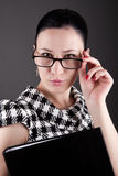 A woman with glasses and folder Stock Images