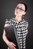 A woman with glasses and folder Stock Photography
