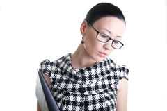 A woman with glasses and folder Royalty Free Stock Image