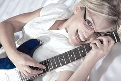 Woman with glasses and guitar Stock Photos