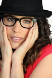 Woman with glasses and hat Royalty Free Stock Images