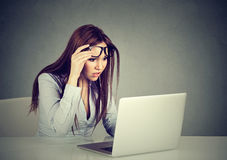 Woman with glasses having eyesight problems confused with laptop Royalty Free Stock Photo