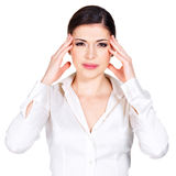 Woman in glasses with headache squeezes the temples Royalty Free Stock Image