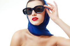 Woman in glasses and headscarf Stock Images