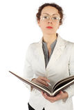 Woman in glasses holding big book and pen Stock Image