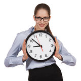 Woman in glasses holding big clock Stock Image