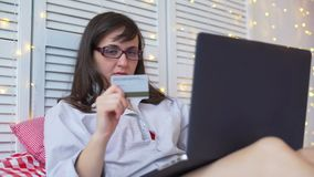 Woman holding a credit card for online shopping stock video footage