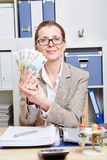 Woman with glasses holding Euro Stock Image