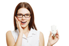 Woman in glasses holding lamp Royalty Free Stock Images