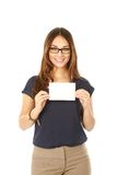 Woman in glasses holding note card Stock Image