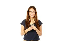 Woman in glasses holding pencils Royalty Free Stock Image