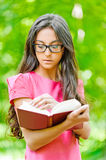 Woman glasses holds book Stock Photo