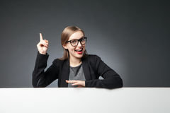 Woman in glasses and jacket with index finger up Royalty Free Stock Images