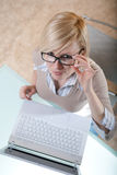 Woman in glasses with laptop Royalty Free Stock Photography