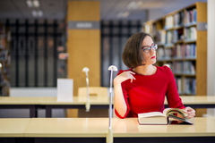 Woman with glasses in library looking left Stock Image