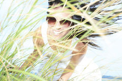 Woman with Glasses  and Long Grass Stock Images