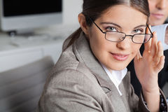 Woman with glasses in the office Royalty Free Stock Photo