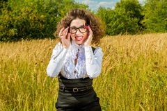 Woman in glasses posing on nature Royalty Free Stock Photos