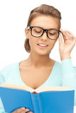 Woman in glasses reading book Stock Photo