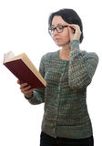 Woman  with glasses reading a book Royalty Free Stock Photos