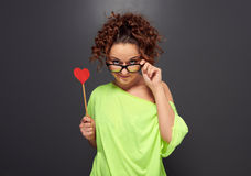 Woman in glasses with red heart Royalty Free Stock Photos