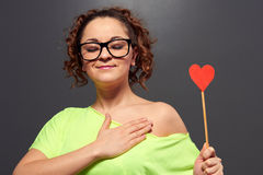 Woman in glasses with red heart Stock Image