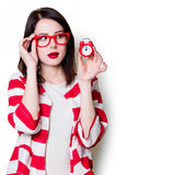 Woman in glasses with retro alarm clock Royalty Free Stock Images