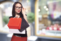 Woman in glasses shopping Royalty Free Stock Photography