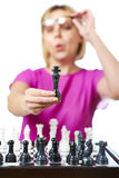 Woman in glasses showing chess king isolated Royalty Free Stock Image