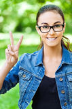 Woman glasses shows victory sign Royalty Free Stock Images