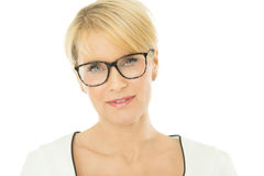 Woman in Glasses. Smart beautiful smiling elegant woman indoors wearing glasses over white background Royalty Free Stock Photos