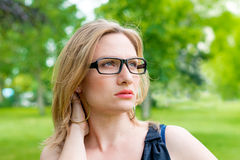 Woman with glasses smiling Stock Images