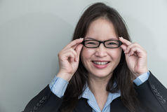 Woman with glasses smiling Royalty Free Stock Image