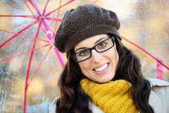 Woman with glasses and umbrella under autum rain Royalty Free Stock Image