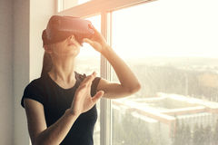 Woman with glasses of virtual reality. Future technology concept. Modern imaging technology. Royalty Free Stock Photo