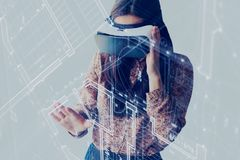 The woman with glasses of virtual reality. Future technology concept. Modern imaging technology. The woman with glasses of virtual reality. Future technology royalty free stock photos
