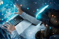 Woman with glasses of virtual reality planetarium. Science and learning have fun . VR glasses playing an exciting. Future technology and innovation concept royalty free stock photo