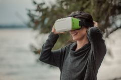 A woman in glasses of virtual reality. Future technologies. Stock Photography