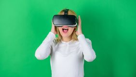The woman with glasses of virtual reality. Woman with virtual reality headset. Happy woman exploring augmented world. Interacting with digital interface stock image